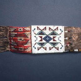 Tobacco Bag, 1890-1900 Native American; Sioux Stitched beadwork; plated quillwork; deer hide, porcupine quills, glass beads, tin-plated tinkler Clara Cupler Kornberg Bequest 1978.019.0009